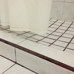 NIce grout and note how the shower curtain is too short