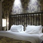 beautiful wallpaper and soft bed