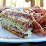Grouper Reuben sandwich with Tabasco onion rings