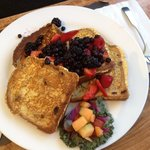 Cinnamon raisin French toast with fresh berries covered in r