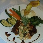 Beef Medallions grilled and topped with Crawfish & Crabmeat, Chimichuri & aged