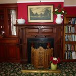 Fireplace and historic photo of Milford Sound