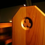 Trefoil reliefs decorate every pew in Lourdes Church.