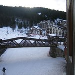 The piste passes under the bridge and past the hotel
