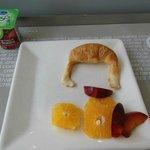 Breakfast - yogurt, media luna and fruit