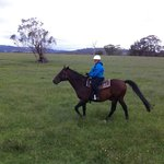 me riding through one of the paddocks