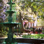 The fountain in The fountain in Lafayette Square with the inn and a carriage in background.