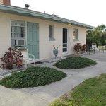 Side door to house(screen door) - green door is single room rental/3rd bedroom entrance