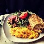 Eggs of the Day, which were scrambled, with pulled pork, green salad, guacamole, and brioche toa