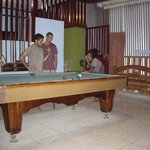 chilling out playing pool after a good day on the beach