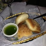 Fresh Italian rolls with pesto olive oil
