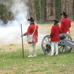 Red Coats fire their canons