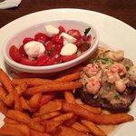 6 oz sirloin with lobster topping tomato salad and sweet potato fries
