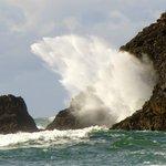 Beautiful waves crashing on the rocks