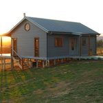 Spa Cottage with sunset behind