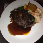 28 Day Dry aged 14 oz New York Strip with Butter Poached Jumbo Shrimp