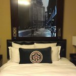 Illuminated picture of NYC above bed