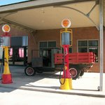 old gas pumps and pick up truck