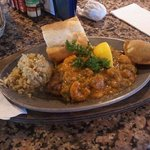Catfish Filet w/ seafood rice topped with shrimp etouffee