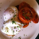 Poached eggs with herby tomatoes served on Granary Bloomer