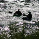 Kayakers on the river photographed from the Strawhouse deck