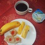 Part of my breakfast:  dumplings, fruit, coffe & yogurt.