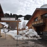 Ski shop, chalet opposite and final run home (red) right behind.