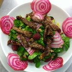 Salad of extra mature sirloin steak toasted walnuts candy beetroot , smoked oil and raspberry vi