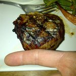 my finger measures 9 cm or 3.5 inches and is up against the steak plus the fork was almost bigge