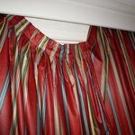 Curtains in hallway right beside the elevator. This really bugged me, I almost fixed them myself