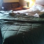 This is how my room looked when I returned at 9pm. Notice huge burn holes in bedspread.