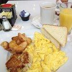 Crab cake and scrambled egg breakfast