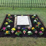 The grave of Wg Cdr Guy Gibsons black labrador, lovingly cared for by the RAF Scampton Head Cura