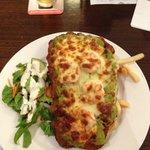Veal schnitzel with prawns, avocado and mozzarella cheese