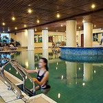 Indoor pool faces the cafeteria, street and lobby.