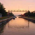 First lock encountered when traveling east of Fairport, NY. Photo looking back toward Fairport.