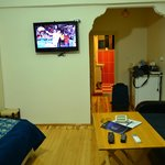 """Arched entrance to the room, 32"""" TV."""