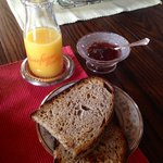 Fresh bread + OJ with homemade jam!