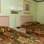 2 double beds (comfortable mattresses, but cramped and outdated room).