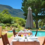 Enjoy breakfast in a nice garden with a heated pool