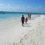 kids enjoying the white sand