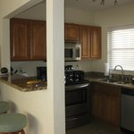 fully stocked open funtional kitchen with breakfast bar