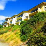 Villas overlook the cycle and walking trail, beach, lake and mountains.