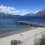 The Villa del Lago beach and jetty.