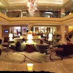 Grand, Stylish lobby, with entrances to a café, a restaurant, a bar...