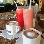 Coffee and fruit juice in breakfast set