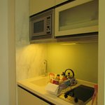 Pantry with microwave, wash basin, cooker, kettle and even dish washing liquid