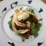 Sun blushed cherry tomatoes on wild rocket with goats cheese and walnuts