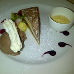 Belgian dark and white chocolate cheesecake served with creme anglaise and ice cream