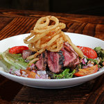 You've got to try out Signature Salad: Charred Romain de Carne Asada!